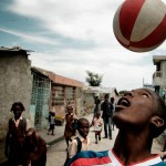 Soccer player Andersoncha is a wizard with any kind of ball - Cité Soleil, Haiti 2008